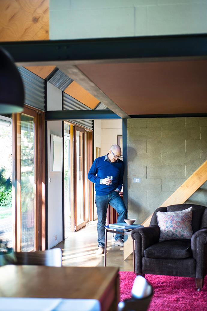 """A smaller sitting area with a dropped ceiling abuts the dining area and kitchen. """"Sitting under the 2.1m ceiling is so cosy,"""" says David."""