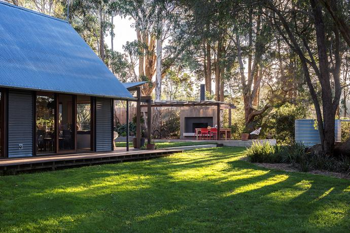 An outdoor fireplace and sitting area under the gum trees is a favourite haunt in both warm and cooler weather.