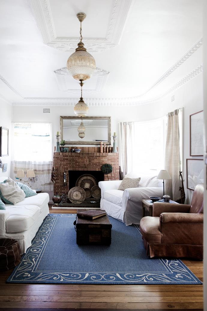 With its chandelier, ornate cornices and fireplace, this room shows off the home's original features.