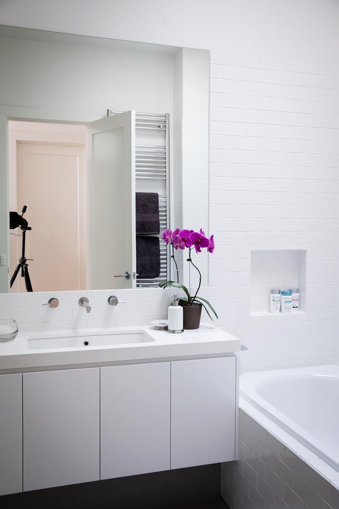 """The [bathroom](http://www.homestolove.com.au/6-budget-bathroom-updates-3599 target=""""_blank"""") walls are covered with handmade subway tiles in a brick pattern."""