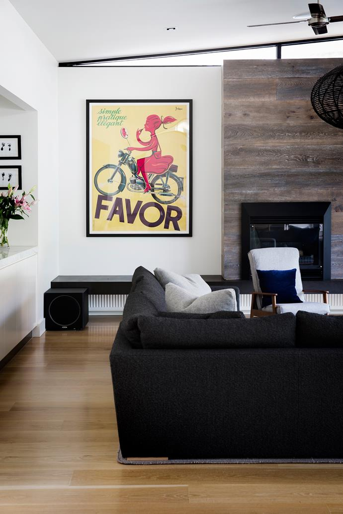 A vintage poster makes an impact in the neutral living area.
