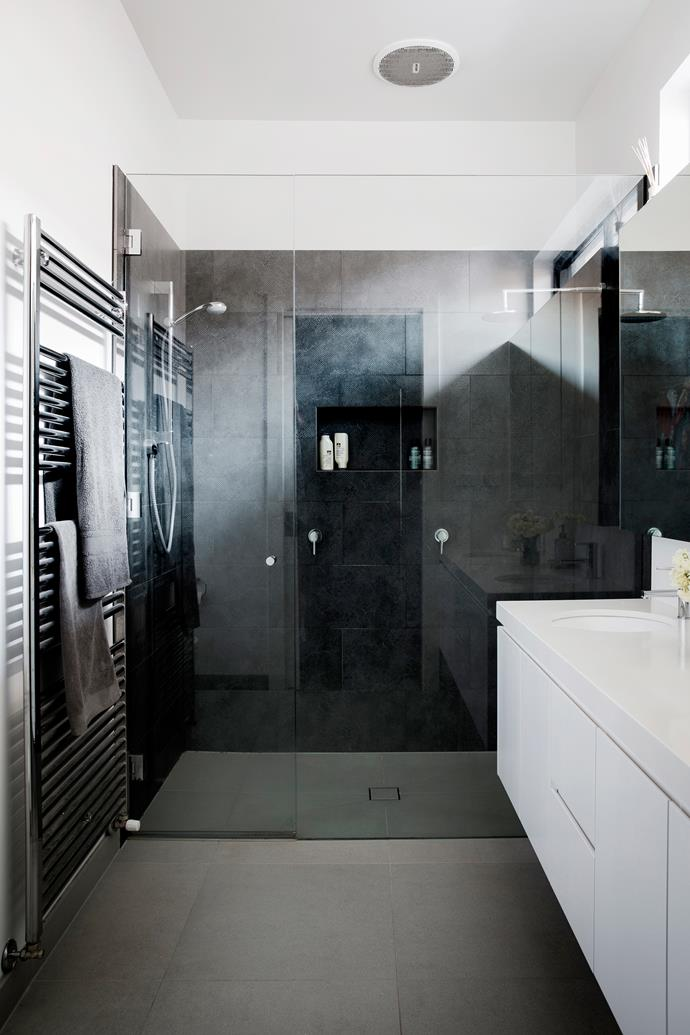 The kids often jump into the master double shower unannounced, Sarah says.