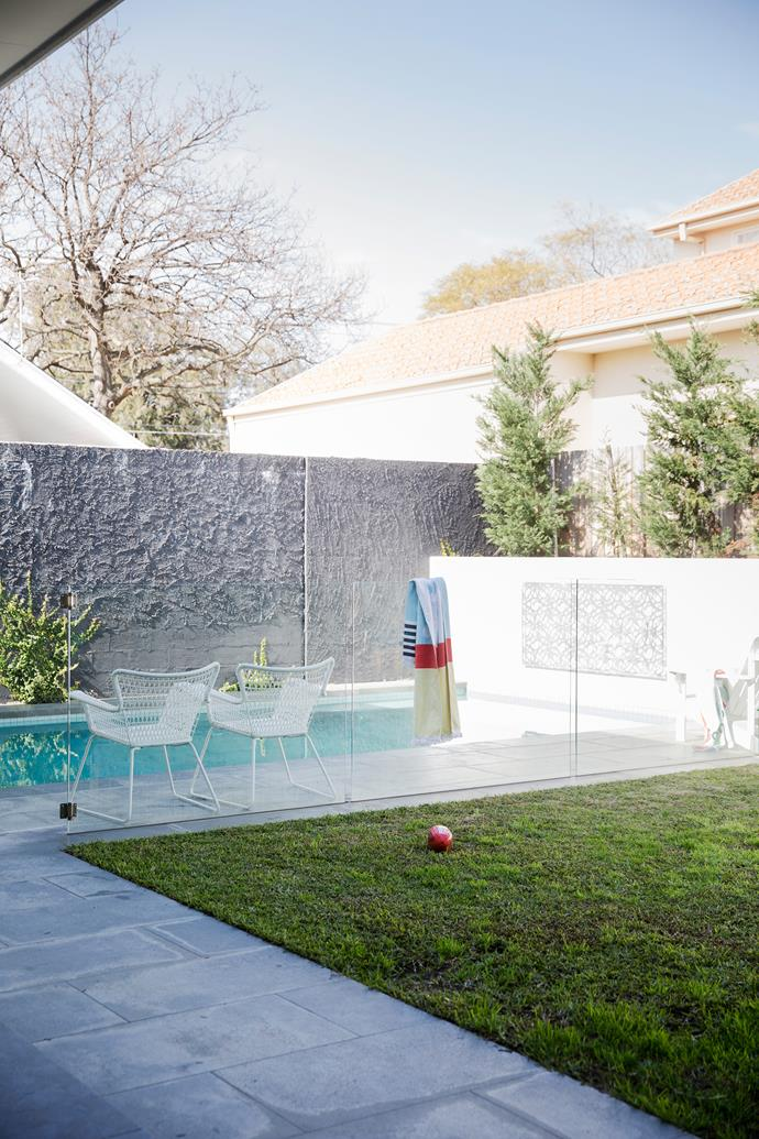"""Large bluestone pavers line the [pool](http://www.homestolove.com.au/yes-you-can-afford-a-pool-2261 target=""""_blank"""") and alfresco areas. """"In summer, the kids spend entire days in the pool; it's the best investment we've ever made,"""" says Sarah."""