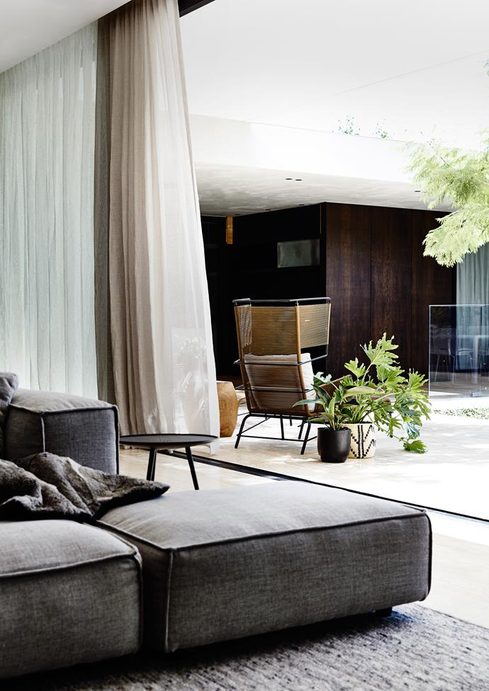 """Travertine in the living area flows outside to the pool while panelled timber walls in the corridor wrap around through to the kitchen and onto the deck. This """"blurring of boundaries results in the perception of a larger, more inclusive space"""", says Bornas."""
