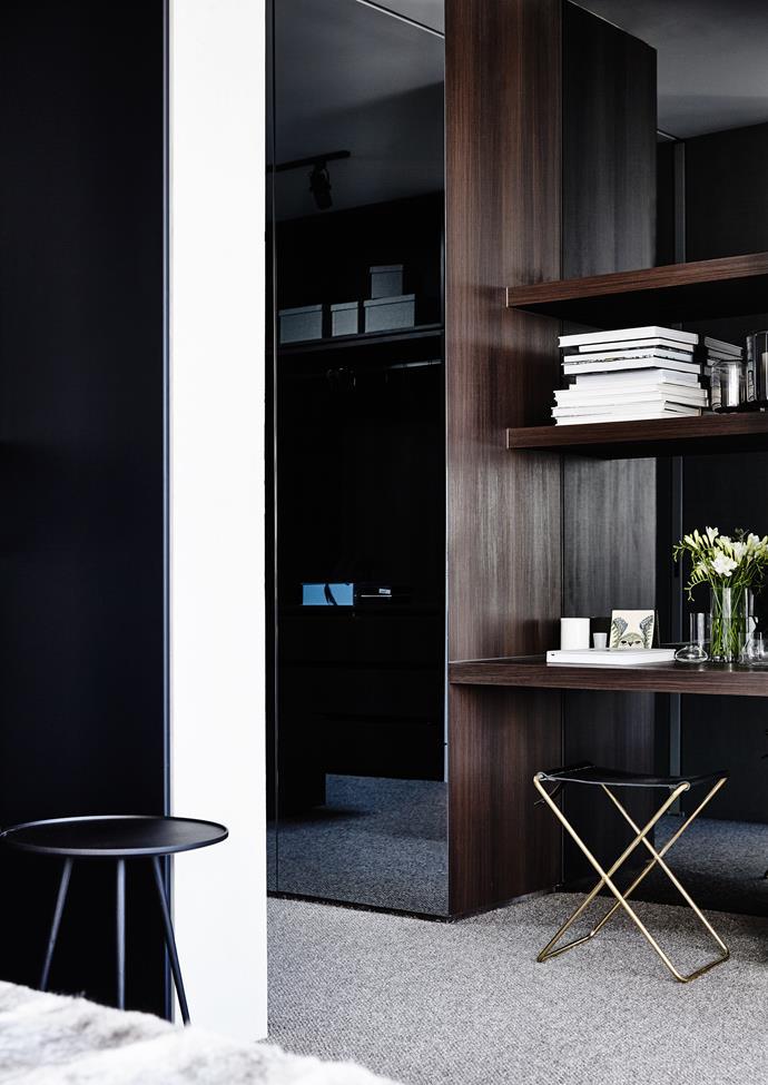 Custom joinery in smoked oak veneer adds polish to the main bedroom.