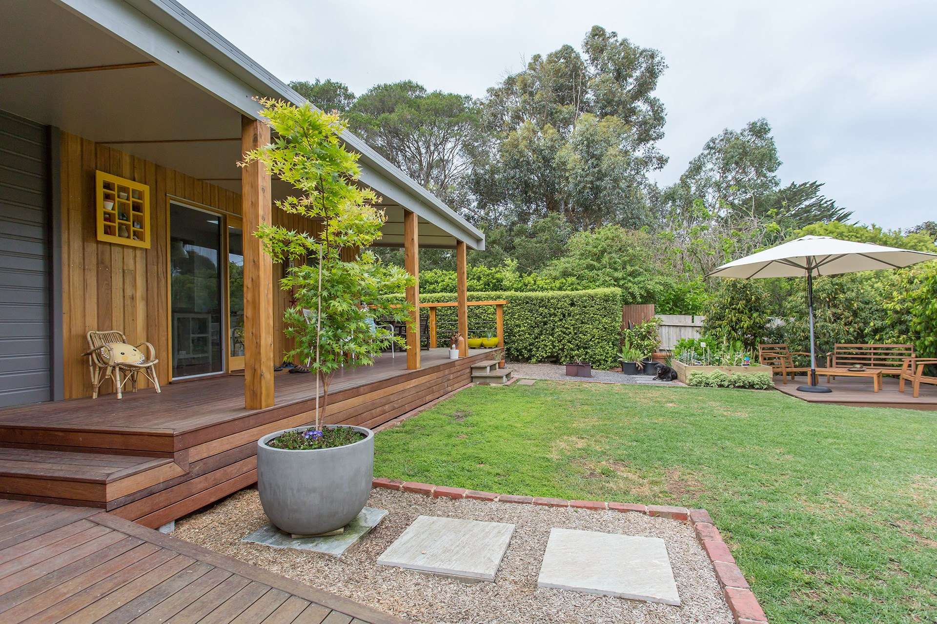 "**Create pathways** – add interest to your garden with pathways as opposed to garden beds. This will result in far less plants to care for. [Take a tour of this garden oasis by the sea](http://www.homestolove.com.au/labour-of-love-beautifies-beachside-backyard-3681|target=""_blank""). *Photo: Katherine Jamison*"
