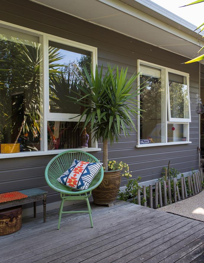 Retro chairs add a splash of colour to the grey-and-white weatherboard house.