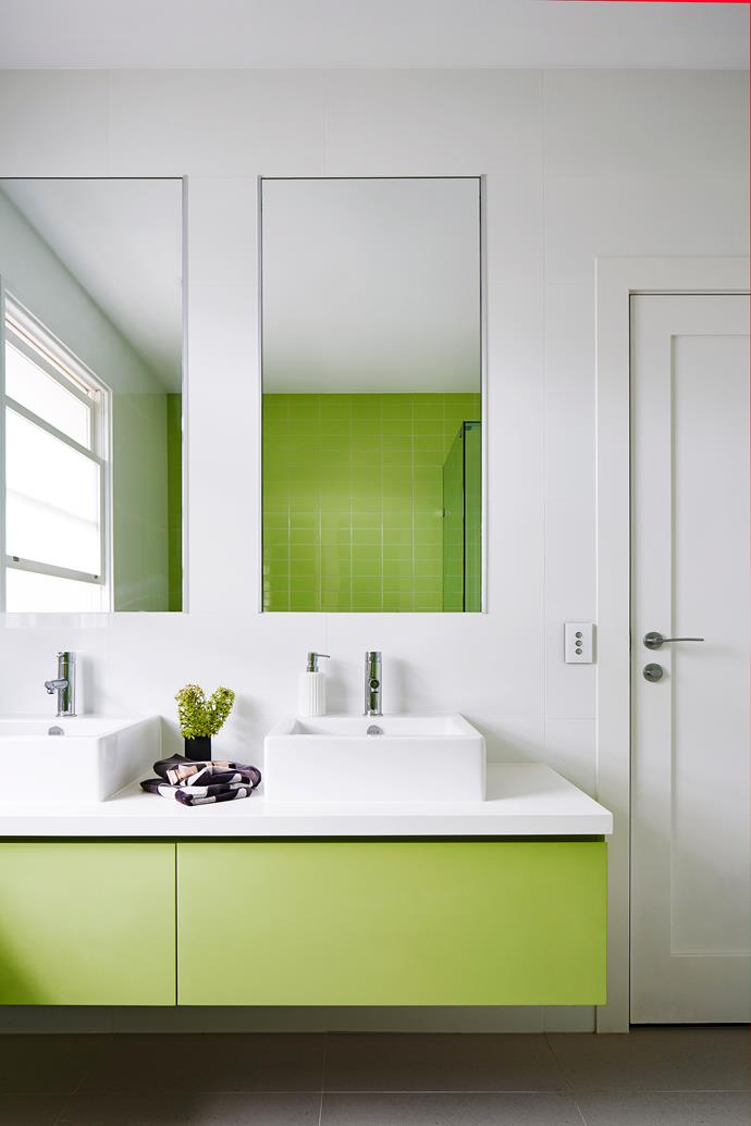 The beautiful pistachio green of the feature wall tiles is echoed in the vanity.
