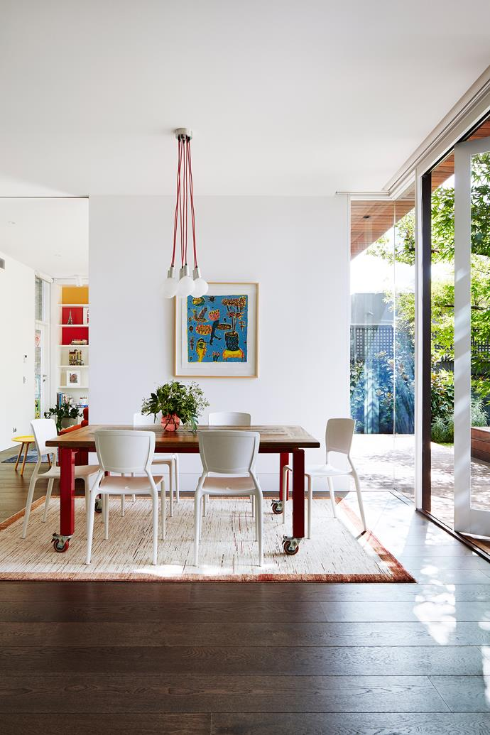"""Pops of red add a cheery note to the [dining zone](http://www.homestolove.com.au/dining-spaces-made-for-entertaining-2704