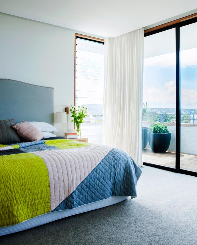 Lightweight curtains on a recessed track retract to let in light and views.