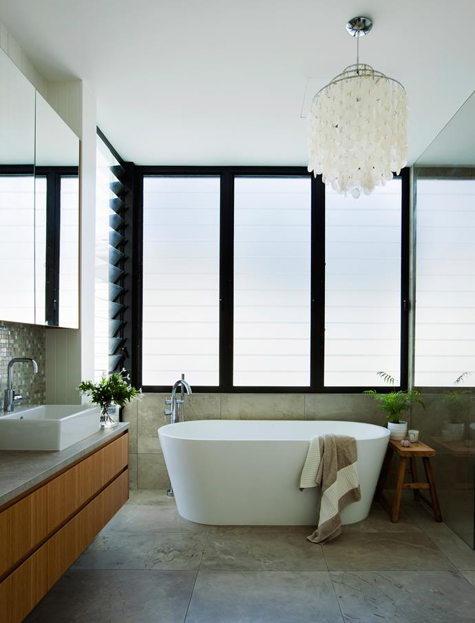 'Bathed in natural light' takes on new meaning in the ensuite bathroom.