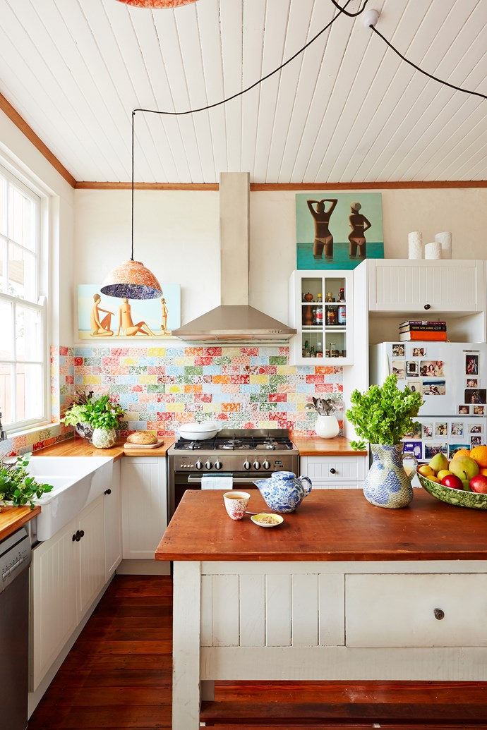 """For something completely different, ceramic artist Samantha Robinson made her own colourful tiles featuring nature-inspired patterns for her [kitchen renovation](http://www.homestolove.com.au/samanthas-patchwork-kitchen-2305 target=""""_blank""""). Photo: John Paul Urizar"""