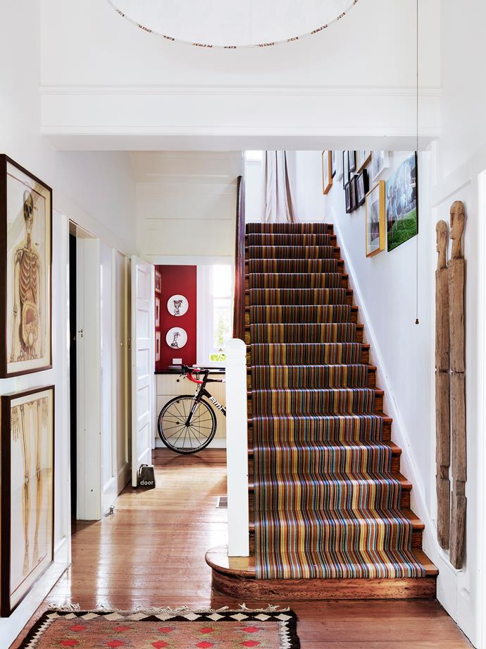 "The approach to the stairs gives a view through to the red [laundry](http://www.homestolove.com.au/5-laundries-that-deserve-to-be-in-the-spotlight-1700|target=""_blank"")."