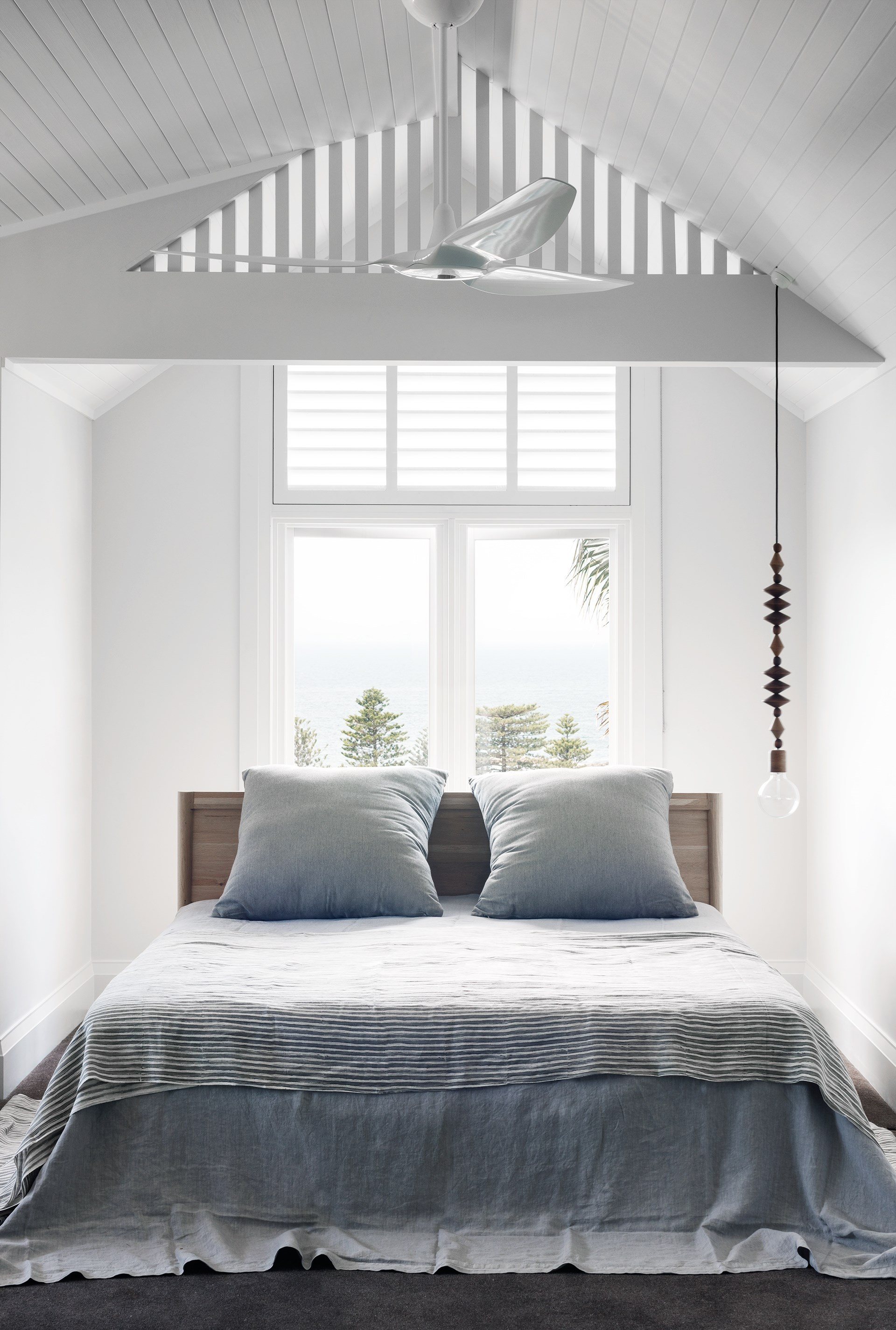 This [seaside sandstone bungalow](http://www.homestolove.com.au/sandstone-house-restored-to-former-glory-3731) has been restored with its heritage in mind. New sandstone has been added as well as an additional story that houses this bright and airy master bedroom with views over Pittwater. Photo: Nicholas Watt / Belle