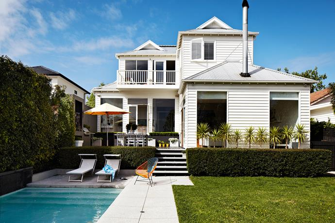 """Versatility was top of mind when Janita and Rob were planning the renovation of this home. """"We wanted Maddie and Charlie to hang out here, with as many friends as they liked,"""" says Janita. The verdant garden, azure pool and white weatherboard facade create a fresh, summery feel yearround."""