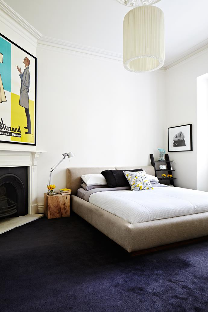 """Janita's fondness for mixing eras is evident in the main bedroom. A vintage poster hangs over the fireplace; the Tolomeo lamp from [Artemide](http://www.artemide.com.au