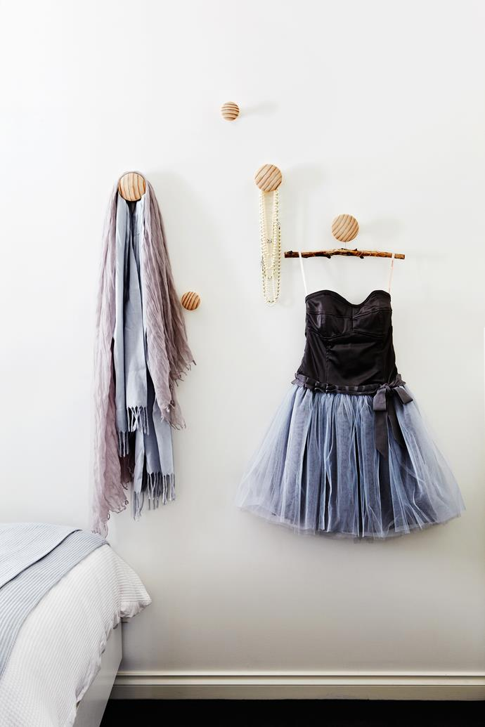 Always save some room for the sentimental bits and bobs – on Maddie's wall is a treasured dress made by Grandma.
