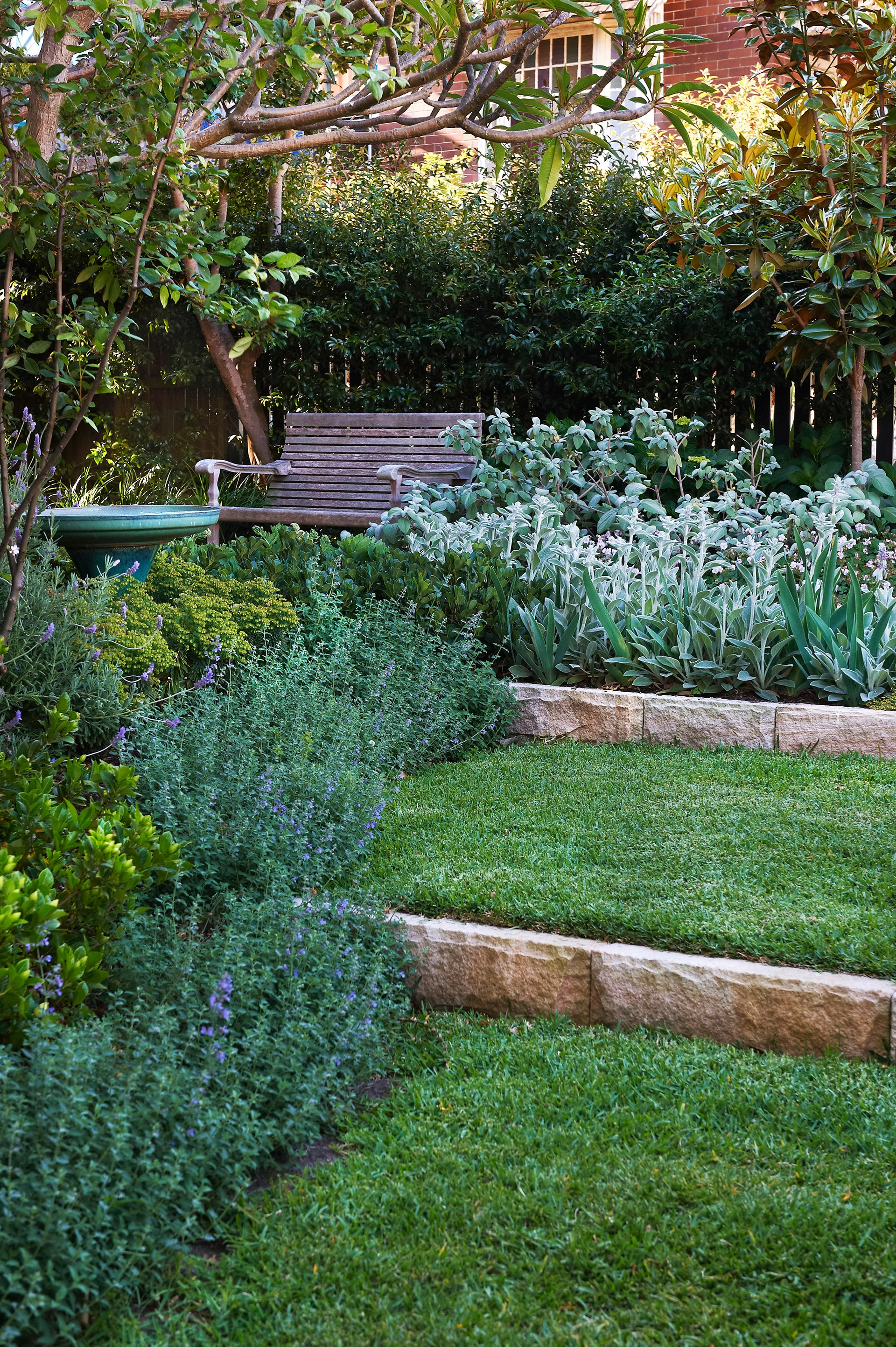 Traditional plants, laid out in a contemporary flowing fashion, soften and settle this [Federation home](http://www.homestolove.com.au/how-to-create-a-soft-perennial-garden-3766) into its block.
