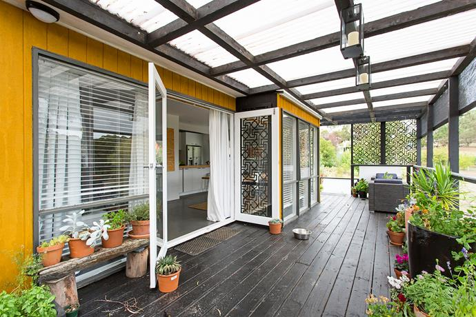 The treated-pine deck has been painted with Wattyl Solagard in Black and the cladding of the house finished in a cheerful yellow.
