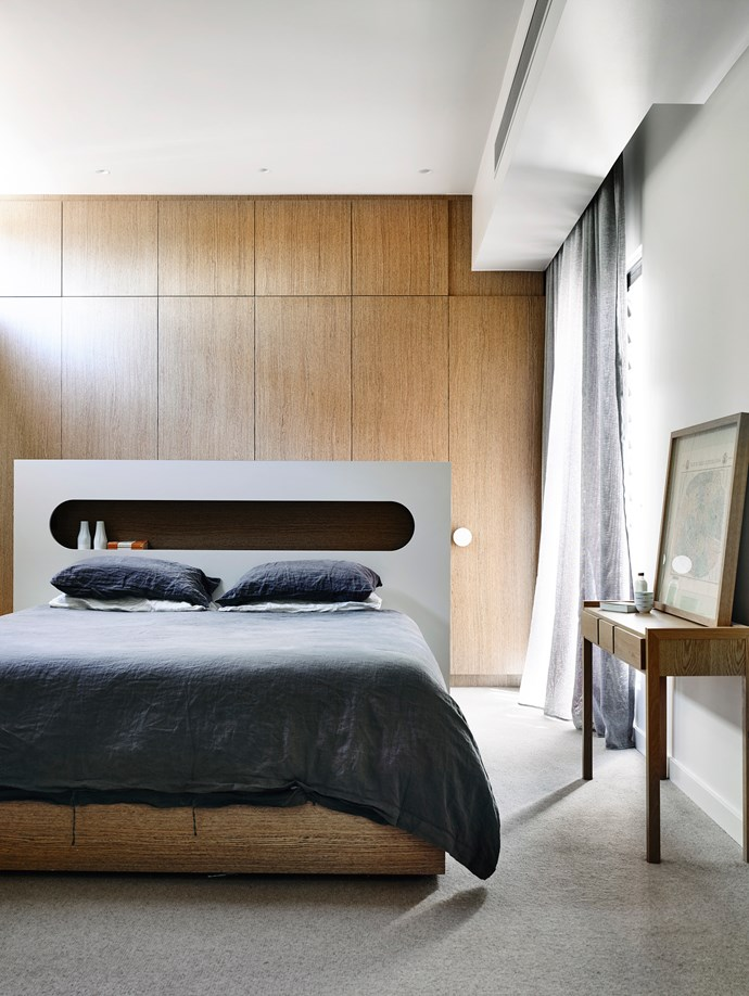 """A bedhead with an elliptical-shaped recessed shelf is a striking feature in this Melbourne bedroom by interior designer [Mardi Doherty](dohertydesign.com.au/?utm_campaign=supplier/