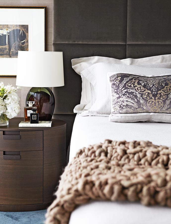 """Grasscloth wallpaper, a velvet-upholstered headboard, silk-cotton bedlinen and a knitted throw work together to create a feeling of sumptuousness in this Sydney bedroom by [Hare+Klein](www.hareklein.com.au/?utm_campaign=supplier/