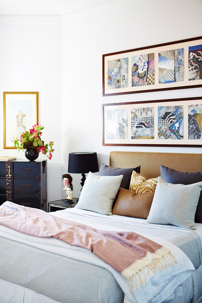 Grey-blue bedlinen adds a relaxed feel to this room. Photo: John Paul Urizar / bauersyndication.com.au.
