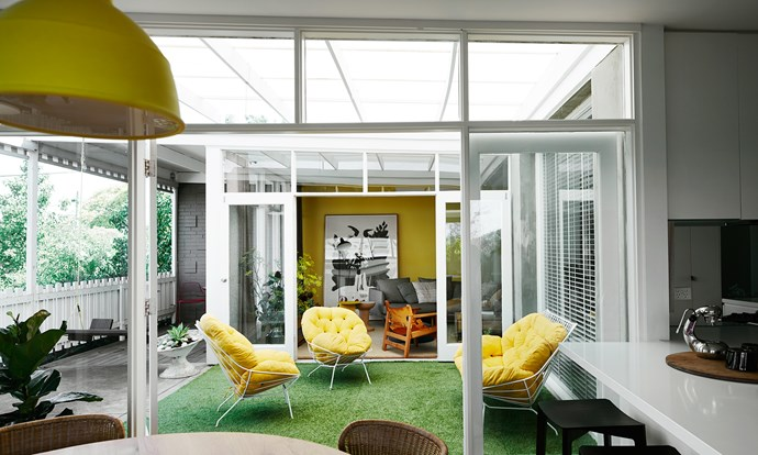 """The dining and living spaces are separated by an indoor/outdoor """"room""""."""