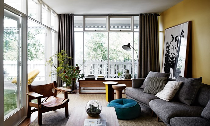 """Vivid hues, mostly sunny yellow and cerulean, feature throughout the home. A plump sofa is positioned to take advantage of the leafy view. The timber [coffee table](http://www.homestolove.com.au/coffee-tables-3192/?utm_campaign=supplier/