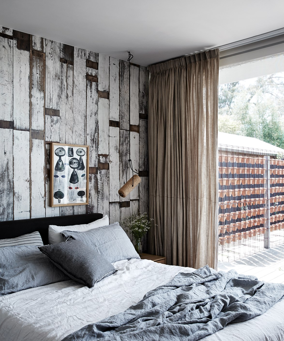 For a modern take on wallpaper, try realistic styles like this faux wood feature wall in this [1960's Melbourne home](http://www.homestolove.com.au/a-cheerful-and-kid-friendly-home-renovation-3774). Rustic and relaxed, this wallpaper works well with natural textures such as linen. *Photo: Sharyn Cairns / real living*