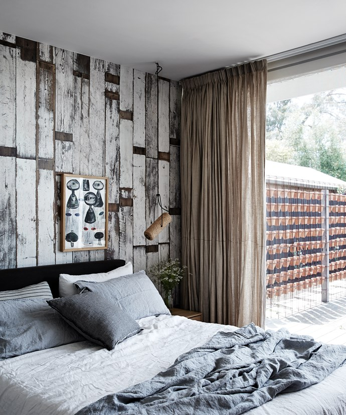 """The master bedroom looks out onto the deck and backyard and has a relaxed feel thanks to the rustic [wallpaper](http://www.homestolove.com.au/wild-about-wallpaper-1486/?utm_campaign=supplier/
