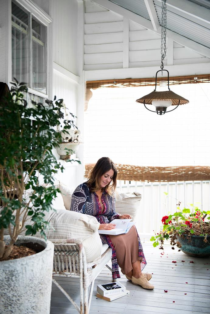 "Photographer, stylist, retailer and [author](http://www.homestolove.com.au/a-peek-inside-australias-country-homes-2371|target=""_blank"") Kara Rosenlund enjoys a quiet moment on the verandah of her cottage in Brisbane."