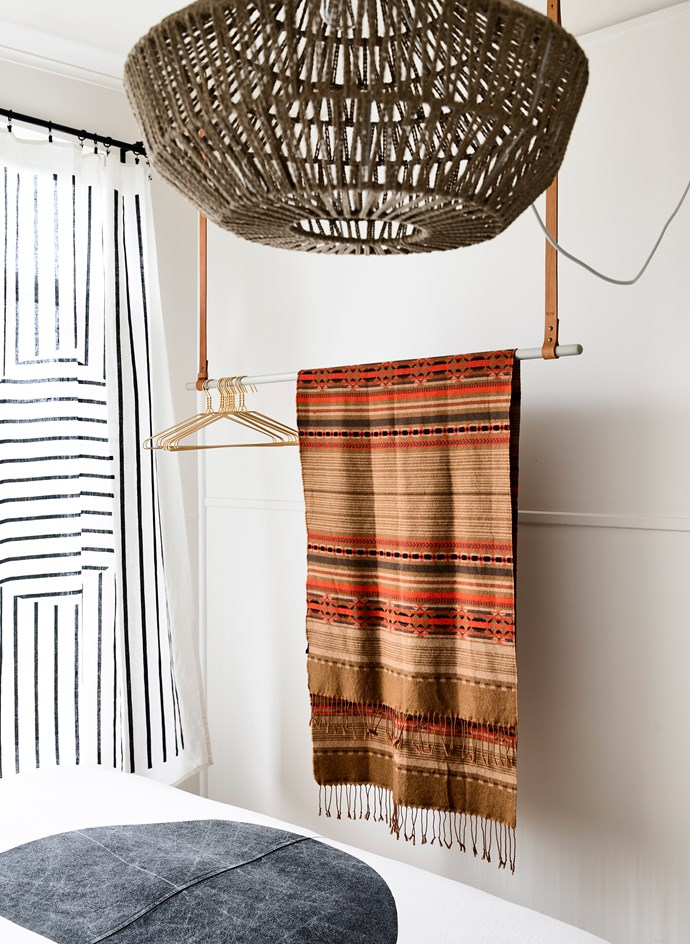 "This woven rope pendant is the hero of the room, while a [Kate & Kate](https://kateandkate.com.au/?utm_campaign=supplier/|target=""_blank"") linen throw is made into curtains."