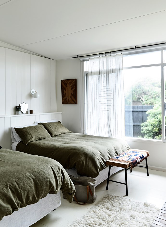 "A guest bedroom features two double beds. The bench is from the [""Sinnerlig"" Ikea range by Ilse Crawford](http://www.ikea.com/au/en/catalog/categories/collections/31586/