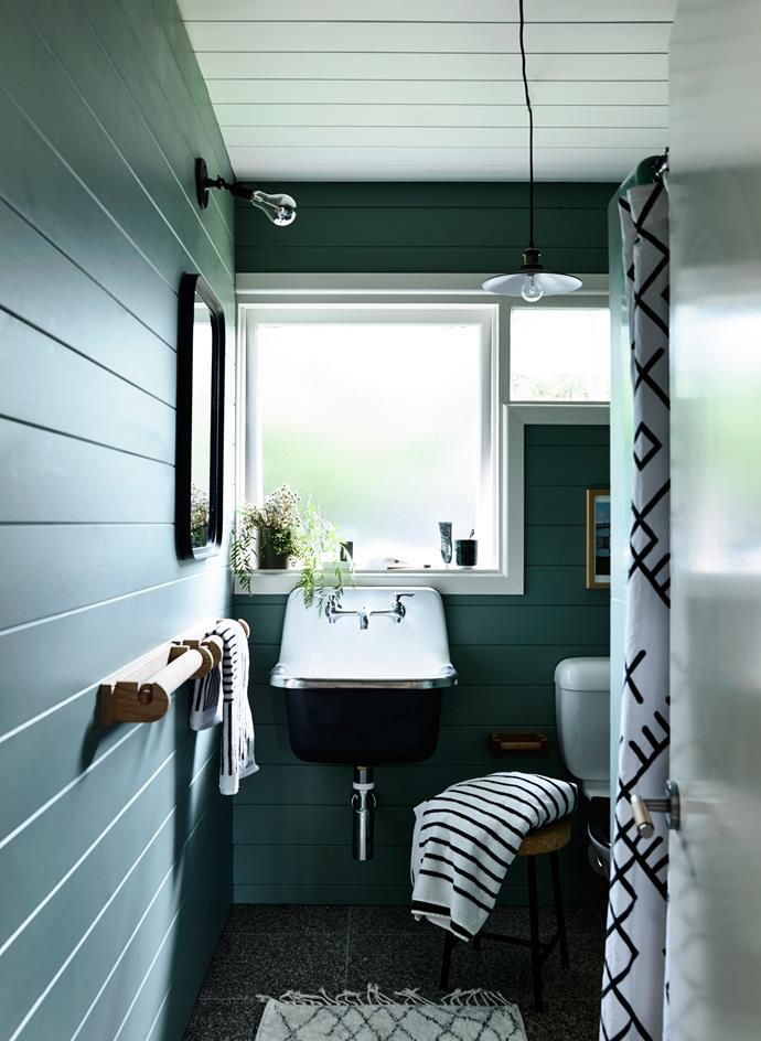 "Lining boards were added to the bathroom, painted in Haymes ""Yukka"", paying homage to the original green fibreglass shower."
