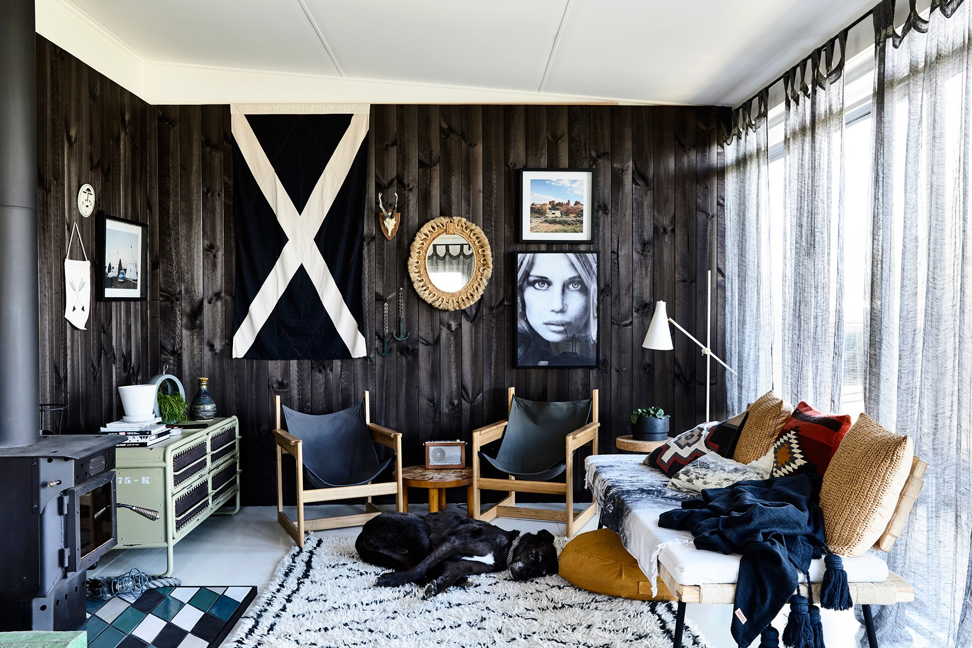 """Scandinavian homes are welcoming and casual spaces (though, stylishly so) and veer away from formality, as can be seen in this living room. The low-line furniture not only invites you to loll around and hang out, it's a great decorating trick making the room seem taller than it is.   See more of this [renovated beach shack](http://www.homestolove.com.au/beach-shack-gets-unique-makeover-3779