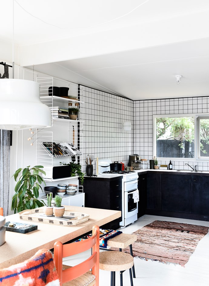 "Simone splurged on three things in the kitchen – she tiled to the roofline to help zone the space, and chose a [Santa & Cole](http://www.santacole.com/en/|target=""_blank"") wall lamp for a beautiful glow, and De'Longhi coffee machine for her morning brew."