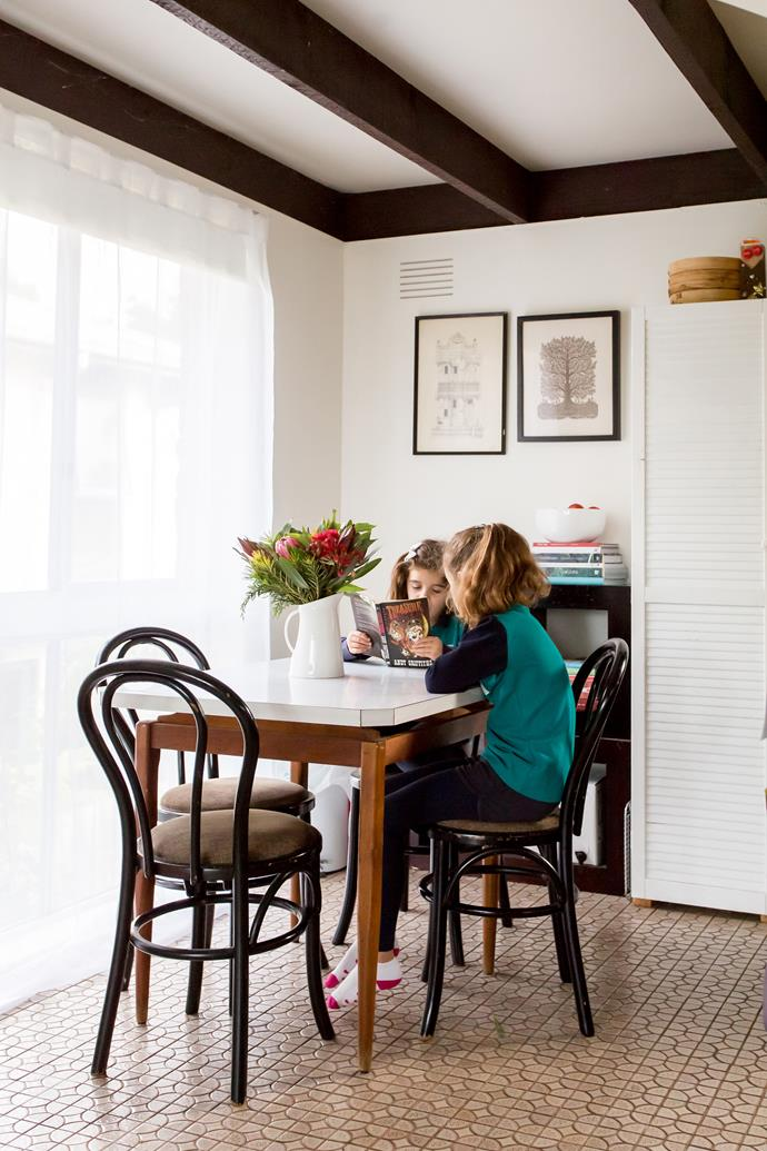 At the apex of the kitchen and living room, the dining room is the hub of daily life. A borrowed table replaces the oversized one in storage.