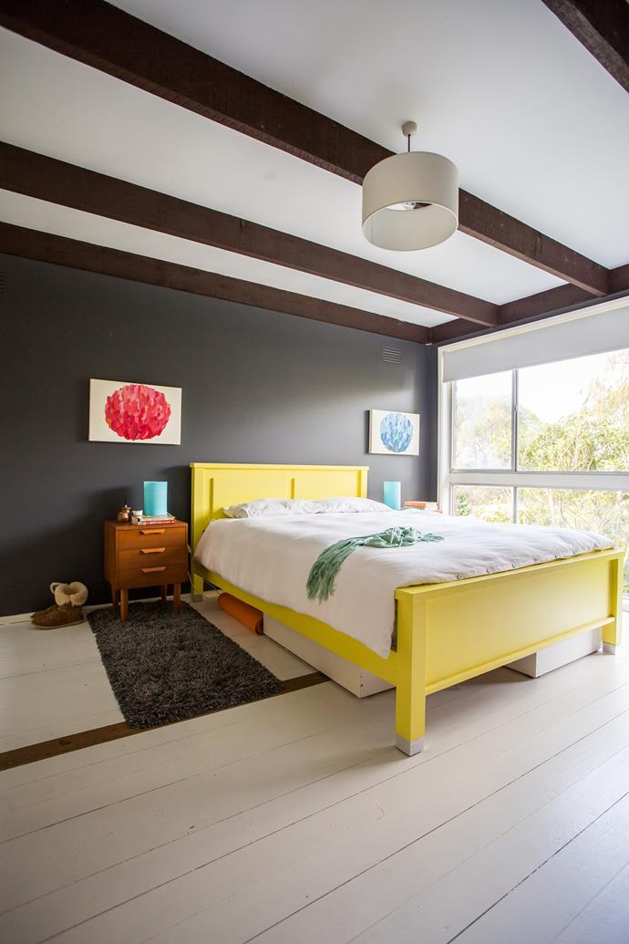 Rather than buying a new bed, Jacqi revitalised her old one with a cheery coat of yellow paint. Tip: dark colour on the walls makes brighter hues really pop.