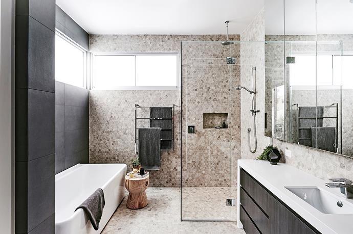 "**Mosaic moves:** Break the rules and ditch the large-format tiles. Instead, run [mosaic tiles]((http://www.homestolove.com.au/bathroom-renovation-mosaic-masterpiece-1641/?utm_campaign=supplier/|target=""_blank"") from the floor up to the ceiling for a seamless effect. *Interior design by [Deborah Schmideg Interior Design](http://www.dsid.com.au/
