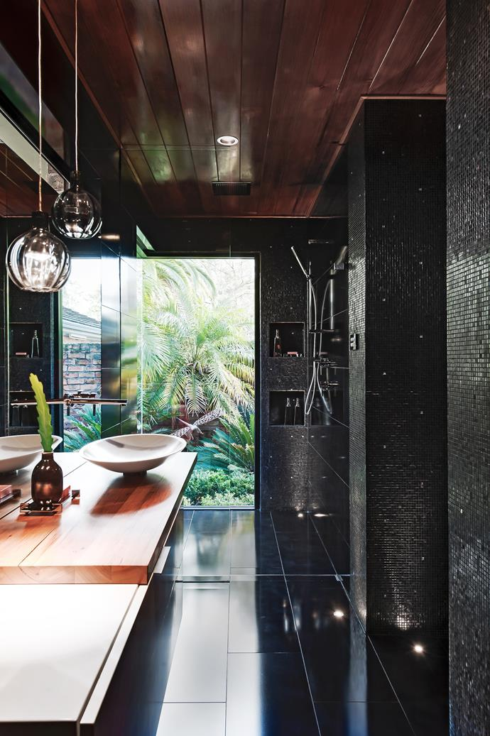 "**Take it outside:** Create the sensation of showering outdoors with a floor-to-ceiling window - if the position is right! Add an overhead rainshower, a wall-mounted rail shower and a timber-topped vanity to help deliver this. Adding some [indoor plants](http://www.homestolove.com.au/7-plants-suitable-for-bathrooms-1755 |target=""_blank"") to your bathroom will have the same effect. *Interior design by [Minosa](http://www.minosadesign.com/