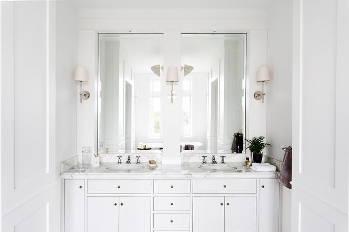 "**Beaming bright:** Transform a small, dark bathroom into a light-filled space with a custom lighting scheme. *Interior design by [PS Design Studio](http://psdesignstudio.com/|target=""_blank""). Photography: Martina Gemmola.*"
