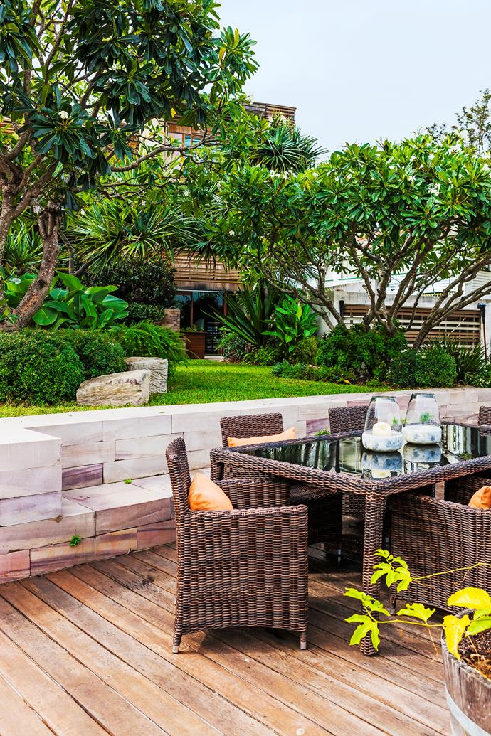 Tropical-style landscaping around the house features lush plantings of gingers, frangipani, heliconias and pandanus.