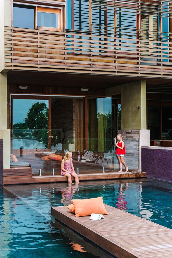 """""""We wanted a natural-looking pool that wasn't Mediterranean blue,"""" says Kimberley. """"I came up with the idea of using purple tiles around the edge."""""""