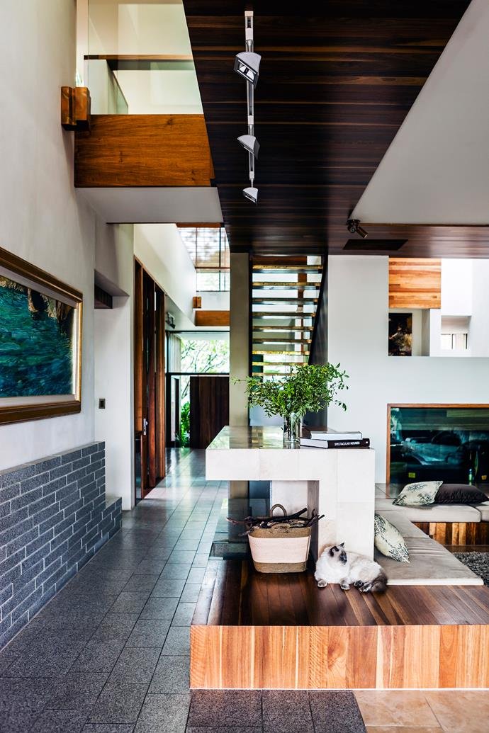 """To maximise light and minimise noise, a feature staircase near the entrance has open treads covered in [Spinneybeck](https://www.spinneybeck.com/?utm_campaign=supplier/ target=""""_blank"""") leather tiles."""