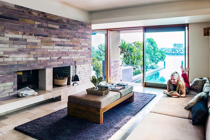 A double-sided wood-burning fireplace in the formal living room keeps things cosy in winter.