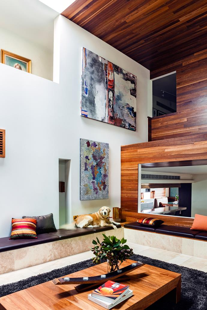 """This central 'gallery' for [artworks](http://www.homestolove.com.au/how-to-shop-for-art-3748 target=""""_blank"""") features a wall of spotted gum and built-in seating. """"It's a nice place to sit and have a glass of Champagne if we're entertaining,"""" says Kimberley. The painting at bottom is by Maureen Hudson Nampijinpa, a Walpiri artist from Central Australia."""