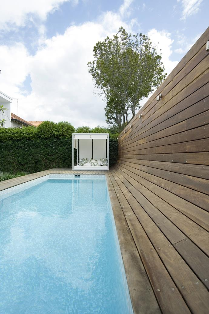 "The installation of this pool plus tiling, decking and lighting came to about $150,000. The curved spotted gum wall by landscape architect Raoul Van de Laak of [GoodManors Pools+Gardens](http://www.goodmanors.com./?utm_campaign=supplier/|target=""_blank"") acts as both the pool fence and property boundary. The 6x2.5m pool is tiled in [Bisazza](http://www.bisazza-australia.com.au/
