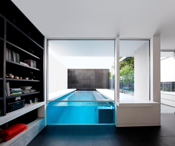 "This 5.4x2.65m pool, designed and installed by [Out From The Blue](http://oftb.com.au/|target=""_blank"") is a rarity. ""It can only be contemplated for a new build,"" says landscape architect, Lewis Marash. Grey mosaic tiles send reflections into the house. A bluestone wall at the far end of the pool ties in with the tones of interior floor tiles. The cost of the project (excluding landscaping) was $98,000."