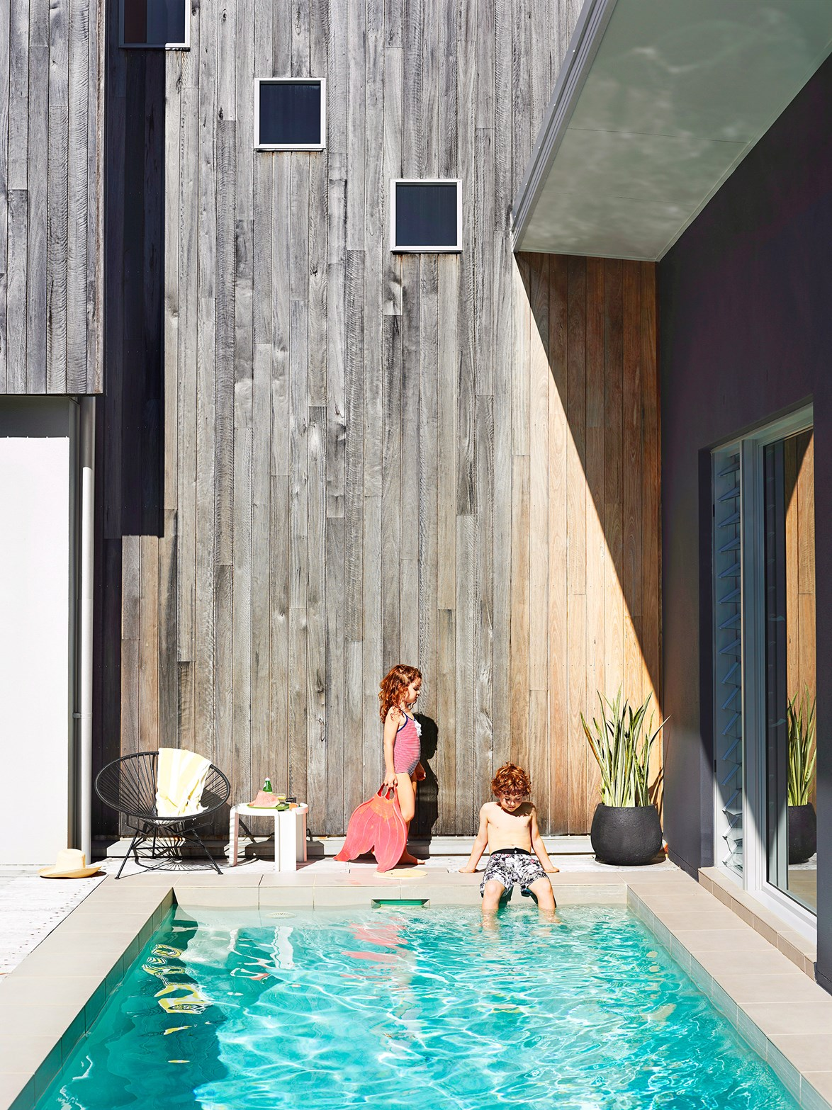 Light-coloured pebblecrete produces aqua water colour in this simple yet stunning pool.