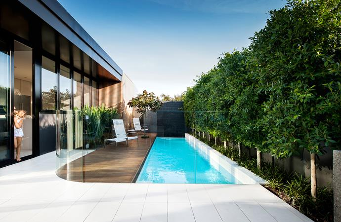 "To soften the intersection between the 8.25m pool and dining area, landscape architect Lewis Marash of [Out From The Blue](http://oftb.com.au/|target=""_blank"") designed a curved-glass pool fence. The pool is tiled with white mosaics, which means the pool water reflects the colour of the sky. The pool is 1.3m deep at the shallow end, dipping to 1.7m in the middle and returning to 1.5m. ""A concave pool floor is key with an in-floor cleaning system,"" says Marash."